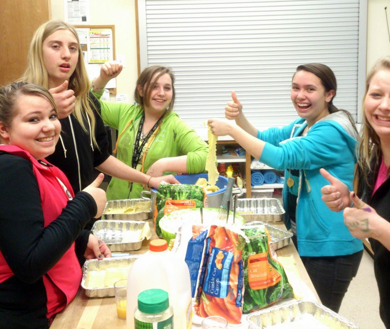 Teens learning to cook lasagna. Yum!