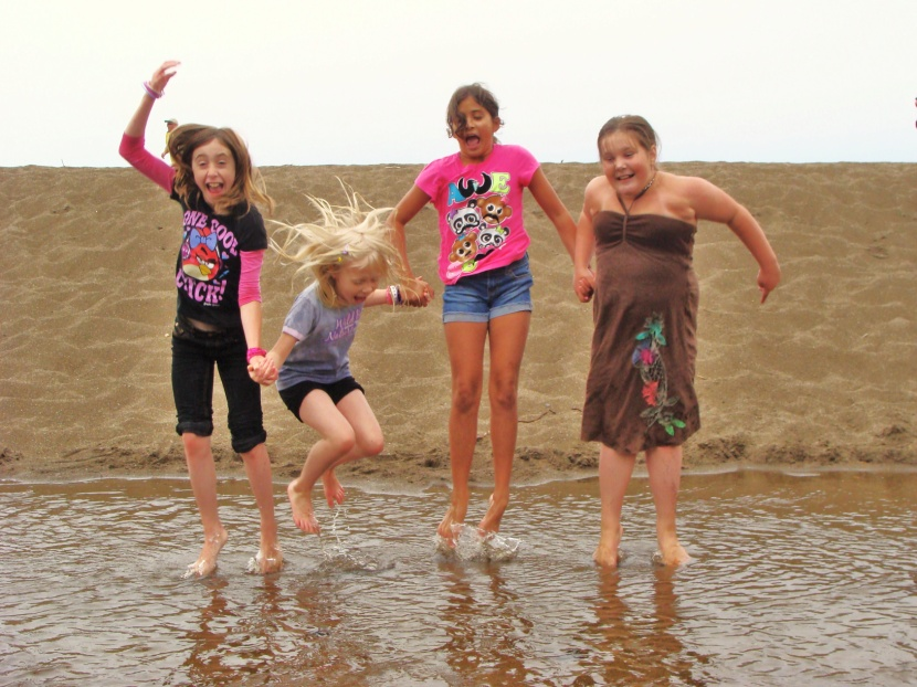 kids jumping in the lake